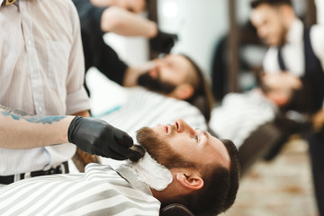 Barbers making a beard form for clients