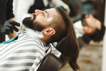 Barber making a beard form for client