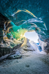 Snow covered rocks in ice cave, iceland