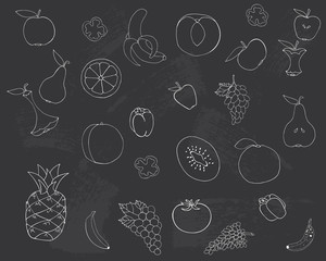 Drawing on the blackboard. Fruits and vegetables are drawn in chalk on a blackboard.