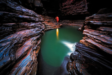 Kermits pool in cave, karijini national park, australia