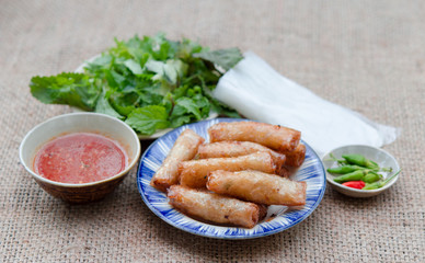 Fried spring rolls with paper rice and fresh vegetables