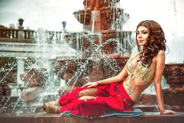 girl lying on the fountain
