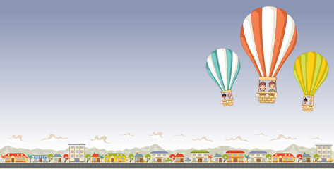 Cartoon kids inside a hot air balloon flying over a suburb neighborhood of a colorful city.