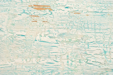 Old shabby wooden surface with cracked blue paint