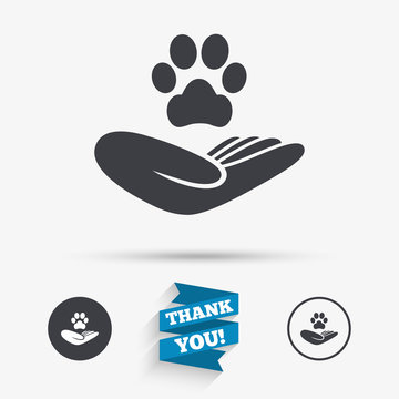 Shelter pets sign icon. Hand holds paw symbol.