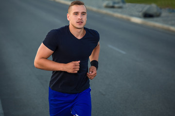 Close-up portrait of athletic man running