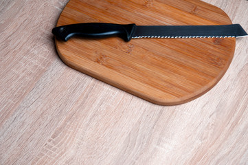 Wooden breadboard with knife