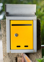 Open mailbox in front of the house