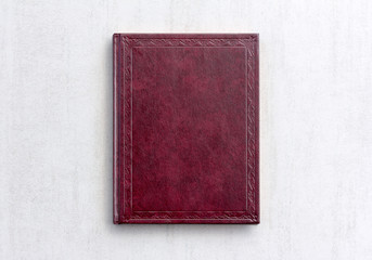 book dark purple color on gray background close-up, top view