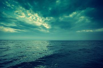 Blue vintage sunset over sea.