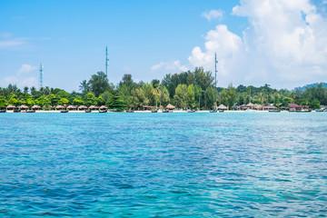 Island blue indigo sea with resort on beach, most abundant coral reef at lipe island,thailand