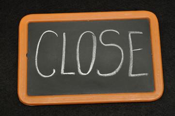 Blackboard with the word close written on it