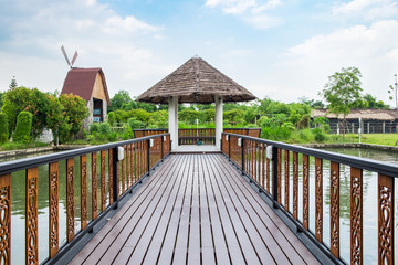 pavilion wooden bridge on lake water in garden