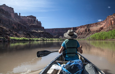 Woman paddling into the Labyrinth Canyon, Utah, USA