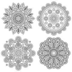 Set of Indian boho floral mandalas, coloring pages template. Vector illustration