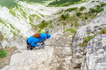 Hiker climbing in the mountain of Alps, Europe