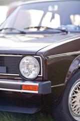 Headlights of old european brown car