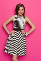 Smiling Girl In Striped Mini Dress