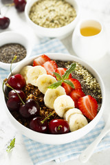 Breakfast bowl with fruits, seeds and berries