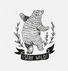 "Hand drawn dancing bear. Vector sketch illustration with stylish lettering ""stay wild""."