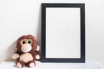 mock up frame and monkey doll in room