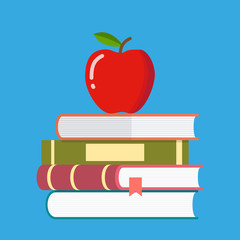 Red apple on a pile of books