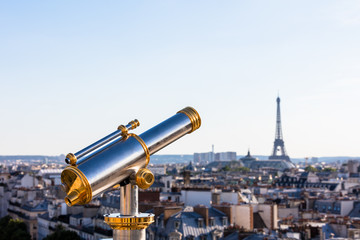 Touristic telescope overlooking Eiffel Tower from the roof of Pr