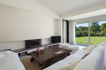living room with white divans