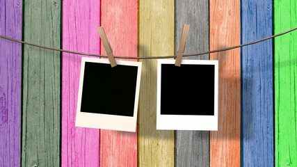 two blank instant photo hanging on the clothesline