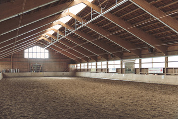 Large vacant indoor equestrian riding school Wall mural