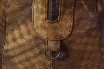 Details of leather bag. Zipper.