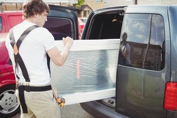 Carpenter taking out door