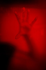 No panic,hand of woman behind stained or dirty window glass,Scary background for book cover