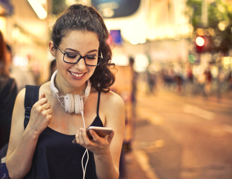 Happy woman reading a text message
