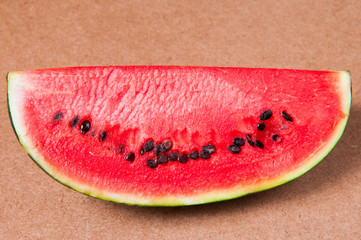 Watermelon on wooden table.