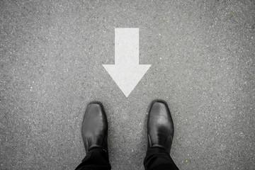 Black shoes and direction sign backward