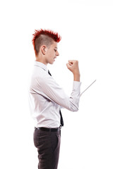 Portrait of serious teen boy with mohawk in shirt and tie using pad against of white background
