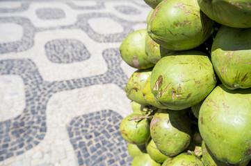 Bunch of fresh green Brazilian coco verde coconuts hanging at Ipanema Beach boardwalk Rio de Janeiro Brazil