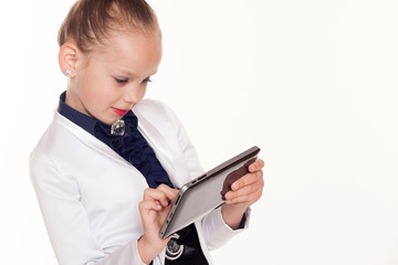 the little girl looks at Internet Tablet