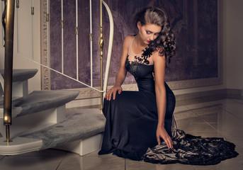 elegant woman dressed in a black dress