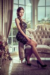 attractive brunette woman on elegant sofa