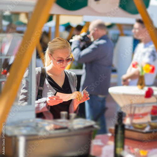 Beautiful blonde caucasian lady buying freshly prepared for E kitchen by urban feast