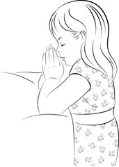 Praying girl, wearing pajamas, kneeling beside her bed at night, with her hands together in prayer.