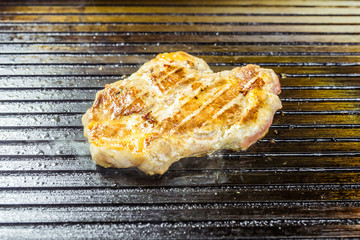 Grilled meat. Juicy steak from pork.