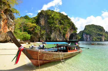 A long tail boats  park in beautiful Island with tourist travel