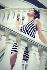 elegant woman smoking a cigarette