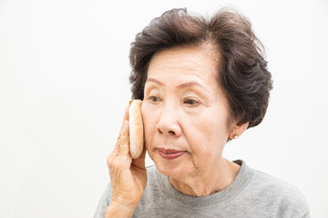 old woman applying make up