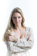 Beautiful Russian blonde girl on a white background in   translucent blouse