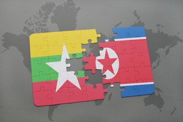 puzzle with the national flag of myanmar and north korea on a world map background.
